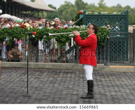 "SARATOGA SPRINGS - August 2: Bugler Sam Grossman plays the ""Call to The Post"" in the  Winners Circle for the next race at Saratoga Springs, NY. - stock photo"