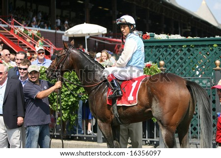 SARATOGA SPRINGS - August 18: Edgar Prado on Law N Dora in the winners circle after winning the Fourth Race August 18, 2008 in Saratoga Springs, NY.
