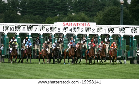 SARATOGA SPRINGS - August 3: The Field leaves the Starting gate to start the Seventh race August 3, 2008 in Saratoga Springs, NY. - stock photo