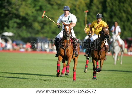 SARATOGA SPRINGS - August 27: Unidentified Polo Players and Horse galloping in fast Action during match at Saratoga Polo Club August 27, 2008 in Saratoga Springs, NY. - stock photo