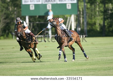 SARATOGA SPRINGS - JULY 10: Loius Galvan attempts to hook Omar Sosa in the opening match of the season at Saratoga Polo Club July 10, 2009 in Saratoga Springs, NY.
