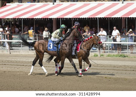SARATOGA SPRINGS, NY - August 29, 2015: #3 Good Response ridden by Luis Saez before the 2nd race on Travers Day at Historic Saratoga Race Course on August 29, 2015 Saratoga Springs, New York - stock photo