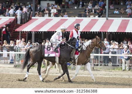 SARATOGA SPRINGS, NY - August 29, 2015: Private Zone ridden by M. Pedroza wins the King's Bishop Stakes on Travers Day at Historic Saratoga Race Course on August 29, 2015 Saratoga Springs, New York - stock photo