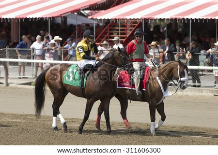 SARATOGA SPRINGS, NY - August 29, 2015: #5 River Dell with L Saez in  post parade for 4th race on Travers Day at Historic Saratoga Race Course on August 29, 2015 Saratoga Springs, New York - stock photo