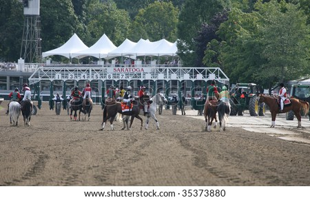 SARATOGA SPRINGS, NY- AUGUST 8: The field approaches the starting gate for The Whitney Stakes at Saratoga Race Track, August 8, 2009 in Saratoga Springs, NY.