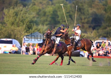 SARATOGA SPRINGS, NY - AUGUST 24: Unknown players in polo during the Ylvisaker Memorial Tournament at Saratoga Polo on August 24, 2012 at Saratoga Springs, New York - stock photo