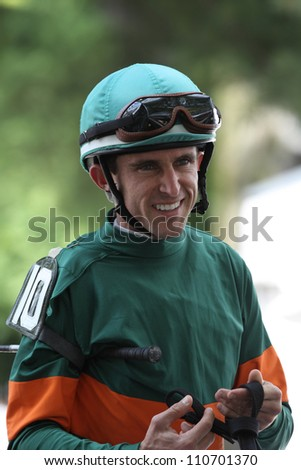 SARATOGA SPRINGS, NY - JULY 27: Jockey Ramon Dominguez rides from the paddock for the second race on July 27, 2012 Saratoga Springs, New York