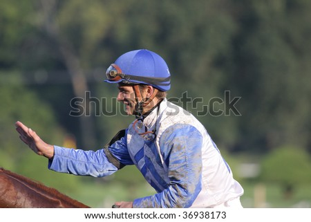 """SARATOGA SPRINGS, NY- SEPT 7: A happy Jamie Theriot aboard """"Dublin"""" after the Grade I Hopeful Stakes at Saratoga Race Track, September 7, 2009 in Saratoga Springs, NY. - stock photo"""