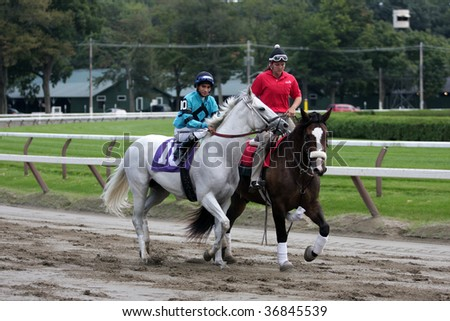 "SARATOGA SPRINGS, NY- SEPT 5: ""White Holiday"" with Alan garcia aboard in the in the post parade for the 6th race at Saratoga Race Track, September 5, 2009 in Saratoga Springs, NY."
