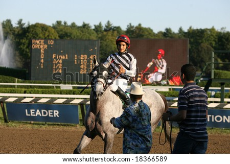 SARATOGA SPRINGS - September 1: Alan Garcia Aboard Vineyard Haven Return to the Winners Circle after the Hopeful Stakes on September 1, 2008 in Saratoga Springs, NY.