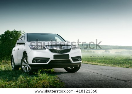 Saratov, Russia - August 11, 2015: Modern car Acura MDX standing on road at sunset - stock photo