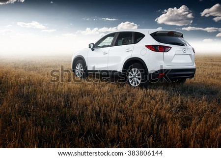 Saratov, Russia - August 30, 2014: White modern car Mazda CX-5 stay on yellow field at autumn