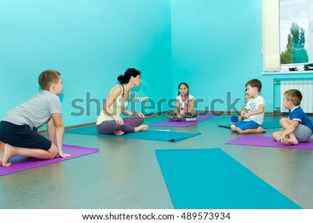 Saratov, Russia - September 8, 2016: Workshops on yoga for kids in developing Studio city. Children do yoga with a teacher instructor. City-wide activity and employment of children.