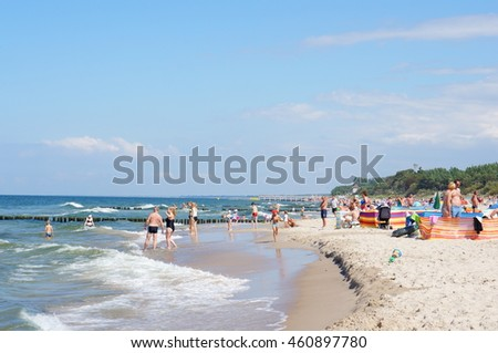 SARBINOWO, POLAND - JULY 30, 2016: Many people on a crowded public beach on a sunny day