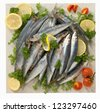 Sardines on marble plan - stock photo