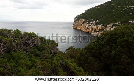 Sardinia coastline, rocky and wild cliffs falling down to the blue sea