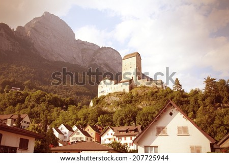Sargans castle in Sarganserland region of canton St. Gallen. Alps in Switzerland. Cross processing color style - retro filtered tone. - stock photo