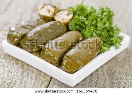 Sarma - Rice and mint wrapped in grape vine leaves. - stock photo