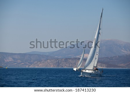 "SARONIC GULF, GREECE - SEP 25, 2012: Unidentified sailors participate in sailing regatta ""Viva Greece 2012"" on Saronic Gulf."