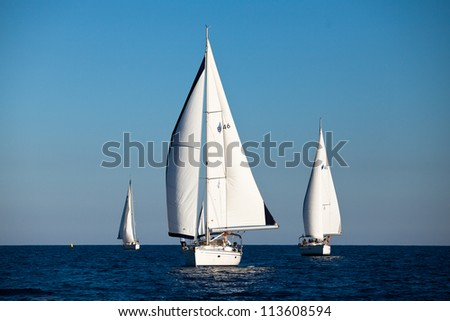 "SARONIC GULF,  GREECE - SEPTEMBER 23: Boats Competitors During of sailing regatta ""Viva Greece 2012"" on September 23, 2012 on Saronic Gulf,  Greece. - stock photo"