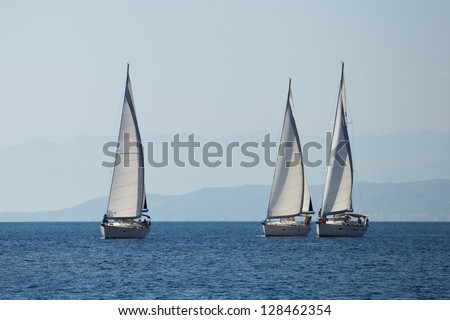"SARONIC GULF, GREECE - SEPTEMBER 24: Boats Competitors During of sailing regatta ""Viva Greece 2012"" on September 24, 2012 on Saronic Gulf, Greece."