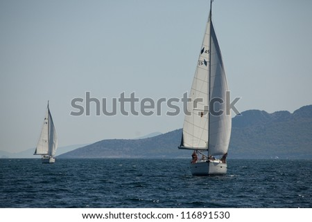 "SARONIC GULF, GREECE - SEPTEMBER 25: Competitors boats during of sailing regatta ""Viva Greece 2012"" on September 25, 2012 on Saronic Gulf, Greece."