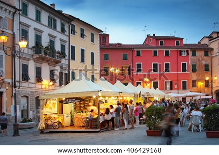 SARZANA, ITALY - AUGUST 10, 2015: People buying traditional Italian dishes on the square - Piazza Giacomo Matteotti in Sarzana, Italy. Summer food festival. - stock photo