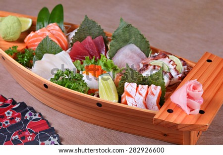 Sashimi , a Japanese delicacy consisting of very fresh raw meat or seafood sliced into thin pieces. - stock photo