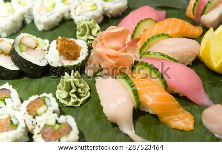 sashimi and sushi roll assortment with ginger and wasabi - stock photo