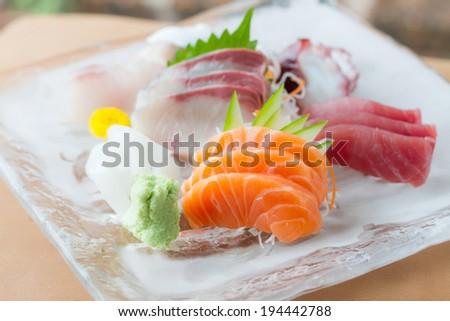 sashimi on iced glass dish, japanese food - stock photo