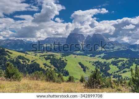 Sassolungo and Sassopiatto mountains  with Sella mountain group behind as seen from a hiking trail around Puflatsch/Bullaccia hill on Alpe di Siusi high alpine plateau, Dolomites, South Tyrol, Italy