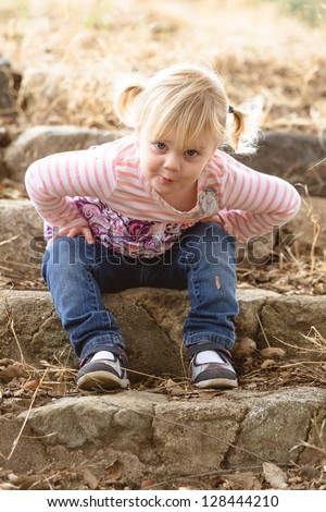 Sassy toddler making a kissing face - stock photo