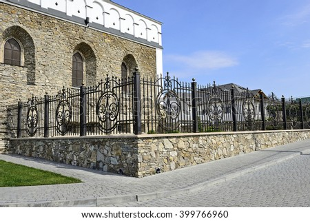 SATANOV KHMELNYTSKIY, UKRAINE- CIRCA SEPTEMBER, 2015: The synagogue of the sixteenth century restored to a quincentenary. Wrought ornamented decorative artistic fence