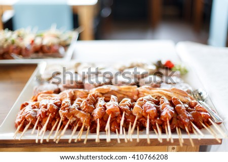 Satay Meat on bbq prepared in restaurant - stock photo
