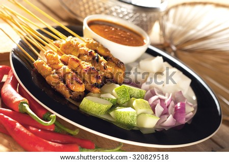 Satay served with onion and cucumber - stock photo