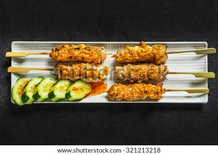 sate ayam Southeast Asian chicken charcoal fire barbecue - stock photo