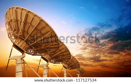 Satellite antenna dusk background - stock photo
