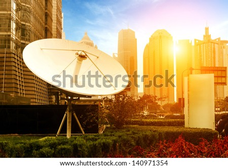 Satellite antenna dusk background - stock photo