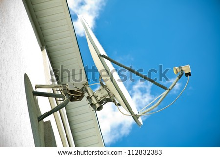 Satellite antenna on a house facade