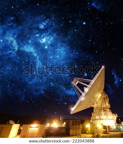 Satellite Antenna under beautiful star in blue sky. Elements of this image furnished by NASA. - stock photo
