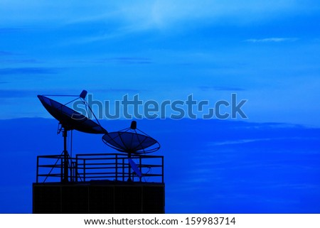 satellite dish and blue sky on dusky time background