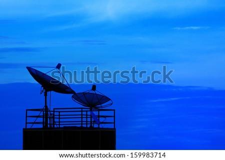 satellite dish and blue sky on dusky time background - stock photo