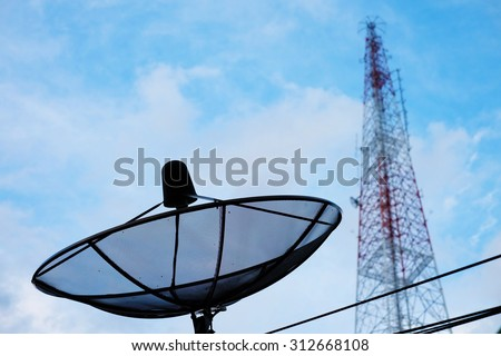 Satellite dish and telecommunications tower with blue sky - stock photo