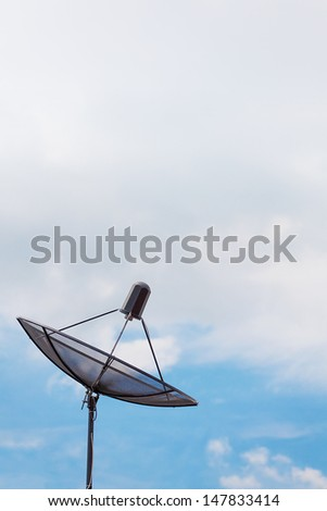 Satellite Dish Antenna with blue sky - stock photo