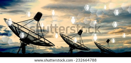 satellite dish antennas on sky and social network - stock photo