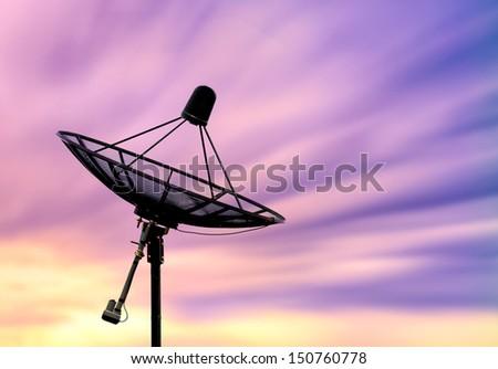 satellite dish antennas under beautiful sky - stock photo