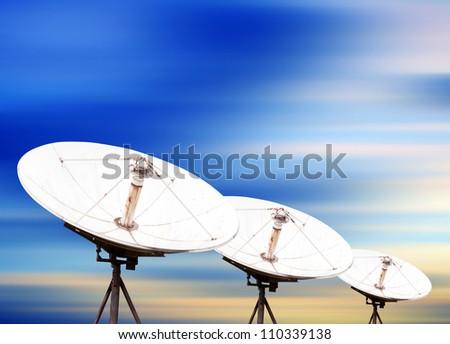 satellite dish antennas under sky - stock photo