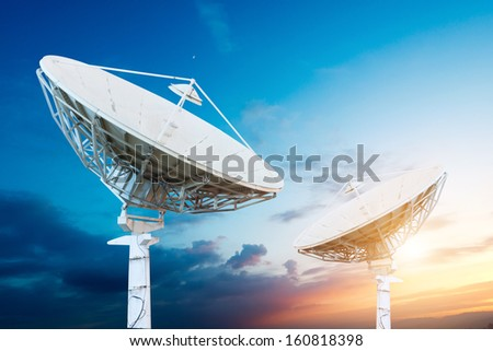 satellite dish antennas under sky - stock photo