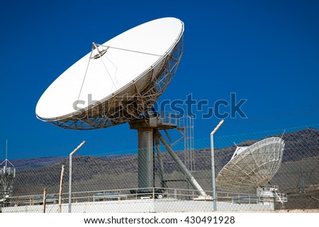 Satellite dish antennas with blue sky.Satellite dish antennas, Spain. - stock photo