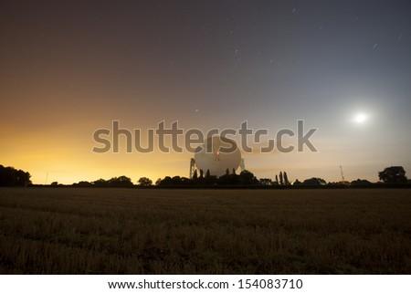satellite dish at night, jodrell bank, cheshire, england - stock photo